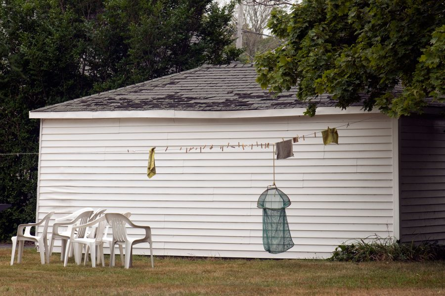 Clothesline and plastic chairs in Jamestown, Rhode Island