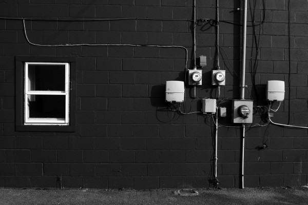 Electrical boxes and window on brick building in Newburgh, NY