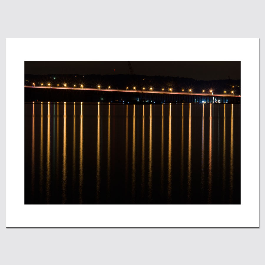 Streetlights on the Tappan Zee Bridge reflected in the Hudson River at night