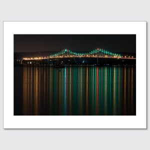 Colorful reflections of the Tappan Zee Bridge at night.