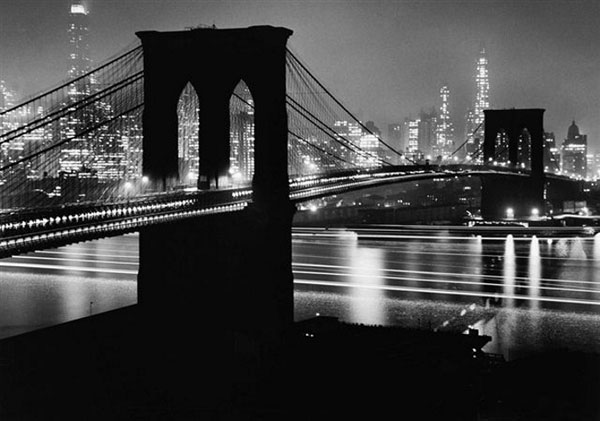 Brooklyn Bridge at night by Andreas Feininger.