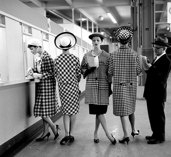 Women at Roosevelt Raceways in checkered coats by Nina Leen.