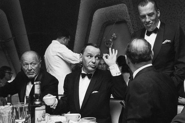 Frank Sinatra at a black tie affair by John Dominis