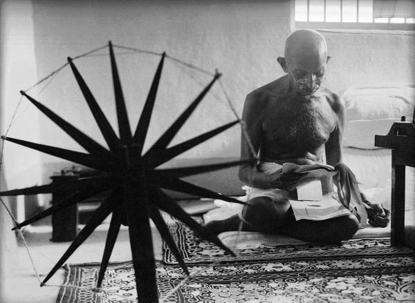 Mahatma Ghandi and his spinning wheel by Margaret Bourke-White.