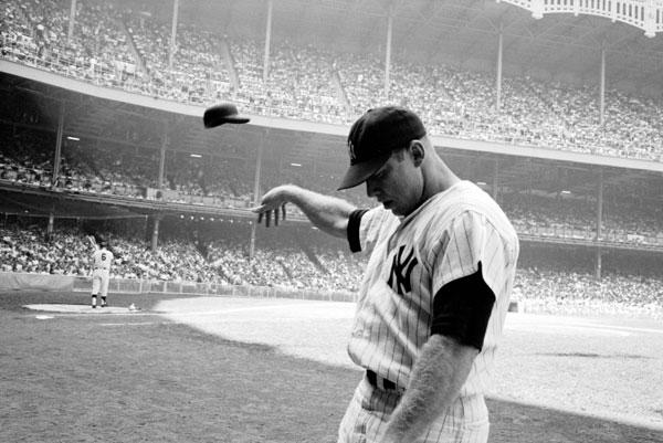 Mickey Mantle tosses helmet by John Dominis