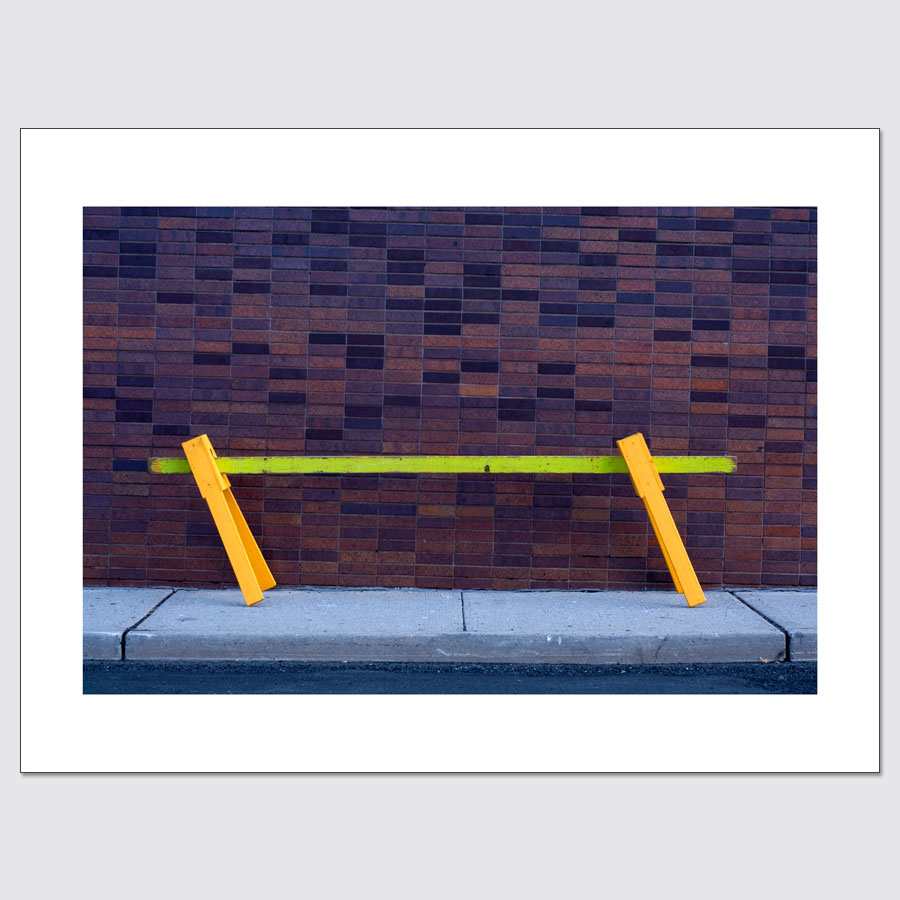 Limited edition photographic print of neon street barrier and brick wall