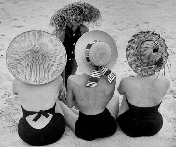Women wearing beach hats by Nina Leen.