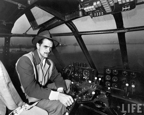 Howard Hughes in cockpit of H4 Hercules plane by J.R. Eyerman.
