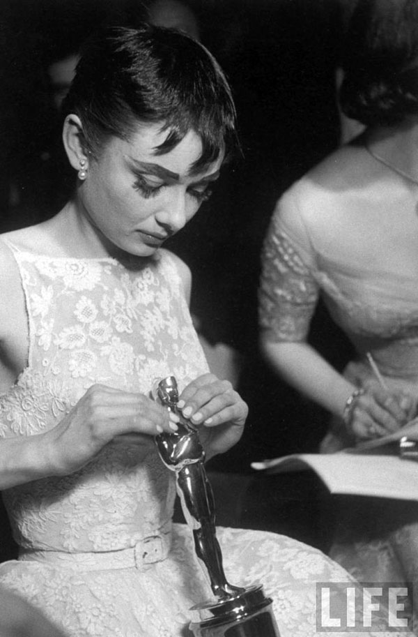 Audrey Hepburn wins Oscar for Roman Holiday in 1954. Photo by Ralph Morse.
