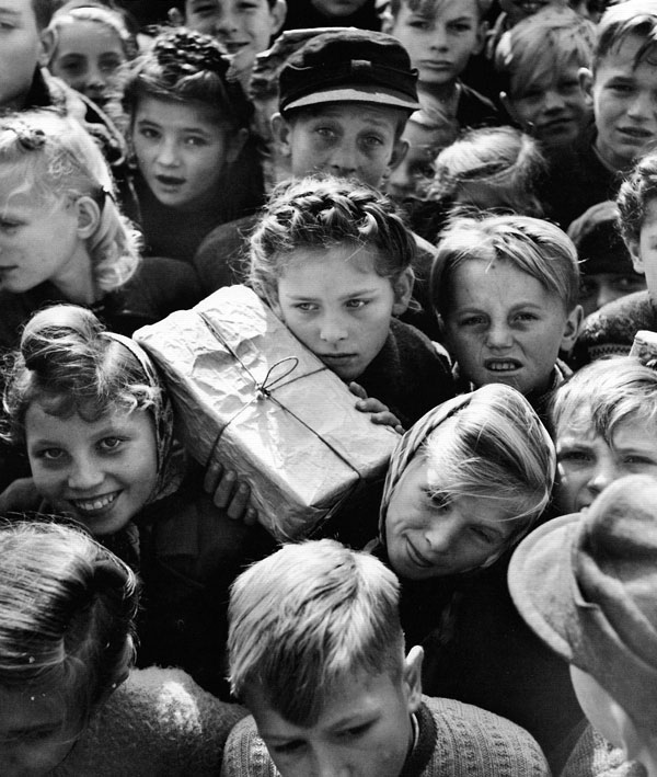 Children with gifts from the Berlin Airlift in 1948 by Hank Walker.