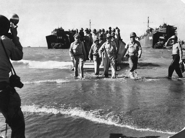 General MacArthur wades ashore at Lingayen Gulf. Photo by Carl Mydans.