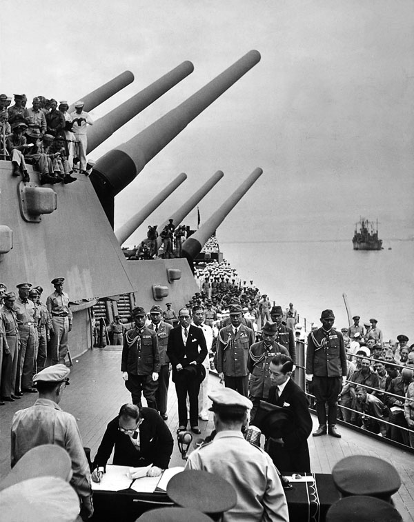 Japanese sign surrender documents on USS Missouri, ending WWII. Photo by LIFE photographer Carl Mydans.