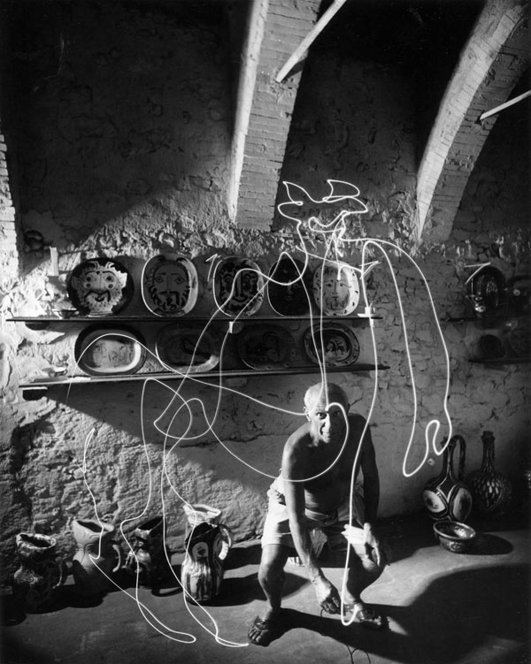 Pablo Picasso draws a light painting in southeastern France. Photo by LIFE photographer Gjon Mili.
