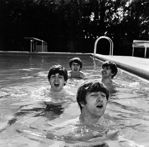 The Beatles take a dip in a Miami Beach pool, photo by John Loengard.